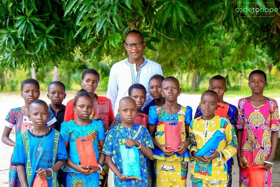 Philemon Padonou with the children of Benin