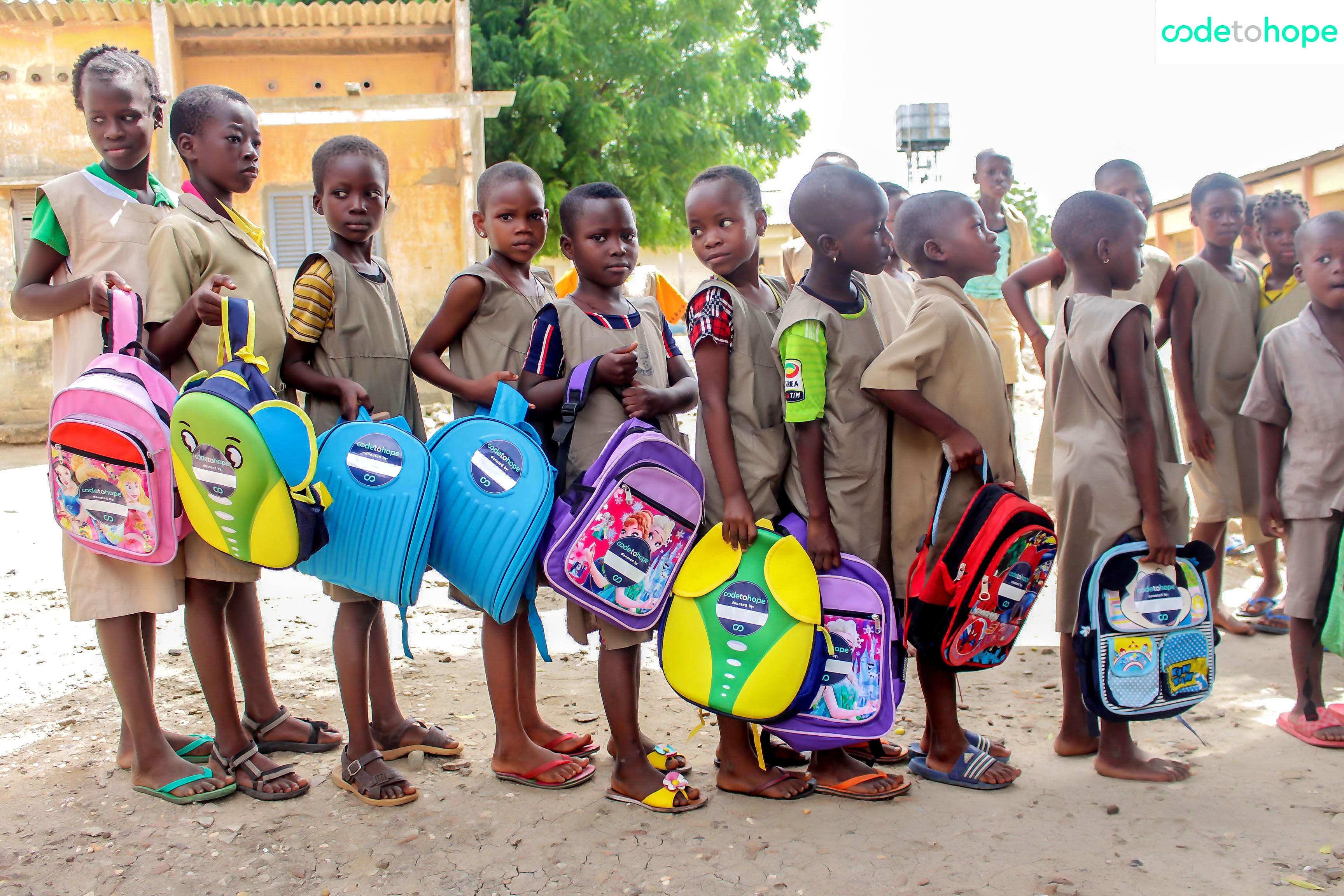 Students receiving their CodeToHope backpacks